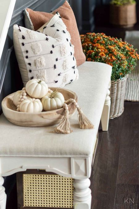It only took a few key items to add fall to my foyer. Home decor fall decor bench fall pillows storage crate plant basket wooden beads Walmart find   #LTKunder50 #LTKSeasonal #LTKhome