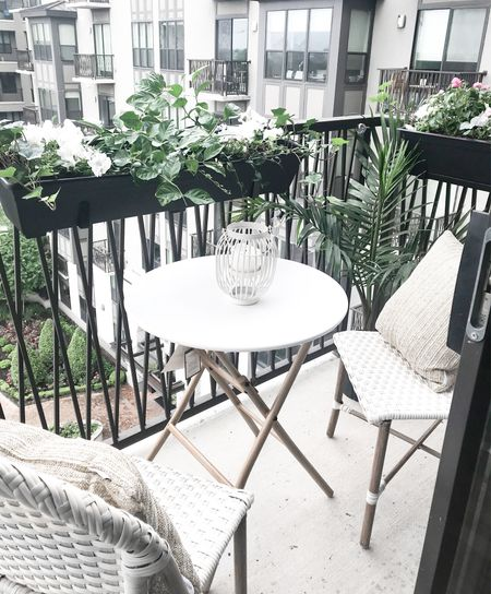 Small space balcony decor with my favorite affordable bistro table and chairs and the best budget-friendly planter boxes.   #target #targethome #lowes #plantdecor #betterhomesandgardens #tjmaxx #outdoorpillows #bistrotable #bistrochairs #wickerchairs #outdoorfurniture #apartmentdecor #balconyfurniture #patiofurniture #affordablefurniture #affordableoutdoordecor  #LTKunder50 #LTKunder100 #LTKhome