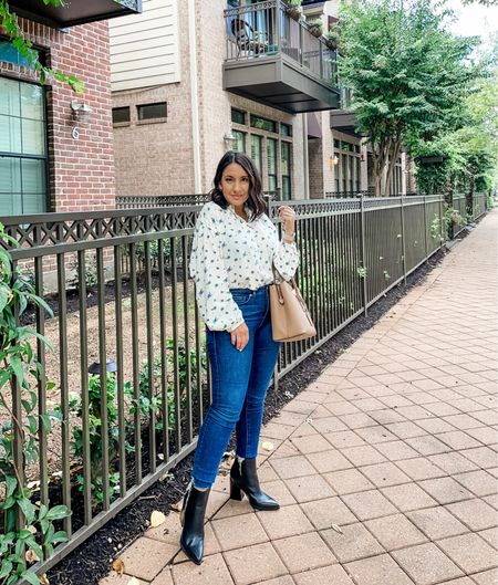 Floral blouse. Runs big. Wearing an xs. Top is 20% off today.  Good American jeans run tts. They have a small amount of give. Jeans are 25% off with code FAM25 Marc Fisher booties run tts.   #LTKunder50 #LTKSale #LTKunder100