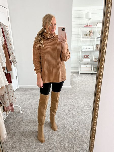 Free people sweater dupe from Walmart! Wearing a medium with back leggings and OTK boots